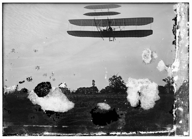 [Left front view of flight 46, Orville shown turning to the left, in the last photographed flight of 1905; Huffman Prairie, Dayton, Ohio]