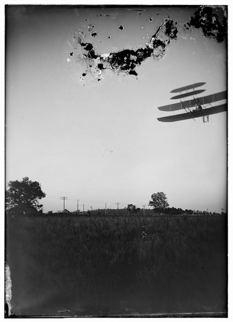 [Left front view of flight 46, Orville turning to the left, in the last photographed flight of 1905; Huffman Prairie, Dayton, Ohio]