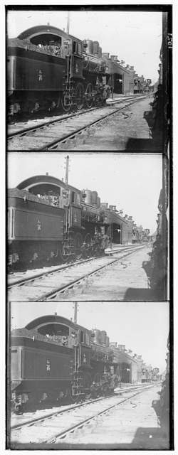 [Locomotive and coal car at a railroad yard]