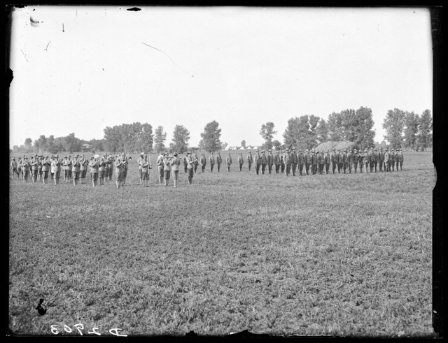 Marching band (left) and troop inspection (right) at the Nebraska National Guard Encampment, Kearney, Nebraska