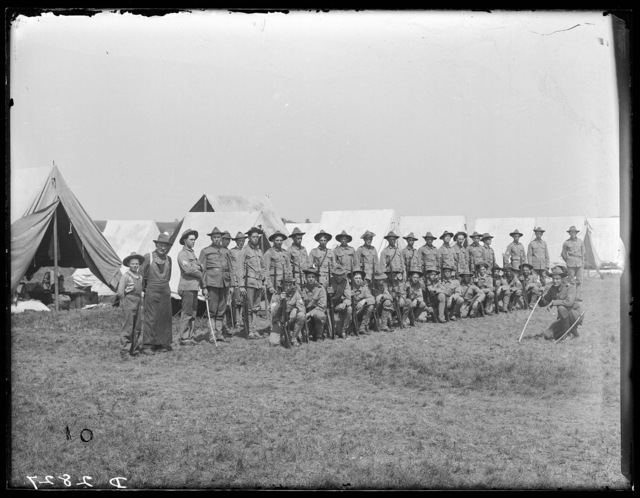 Nebraska National Guardsmen lined up in front of the tents near Kearney, Nebraska.
