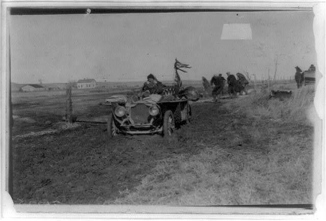[New York to Paris automobile race - five men trying to pull automobile out of mud]