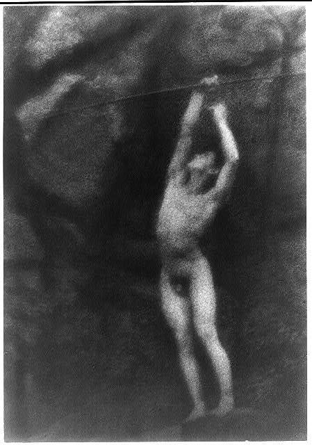 [Nude youth with bow and arrow, arms raised as if to shoot arrow into air (cropped)]
