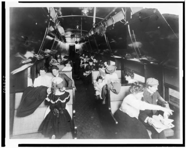 [Passengers in a railroad car] / Photo by the Geo. R. Lawrence Co.