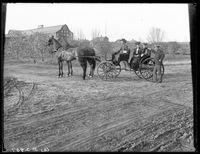 People in a carriage in front of the Watson Ranch barn near Kearney, Nebraska.