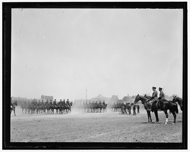 Pershing & Col. Rivers reviewing the Third Regiment Cavalry at the celebration of its 76th birthday anniversary. May 25