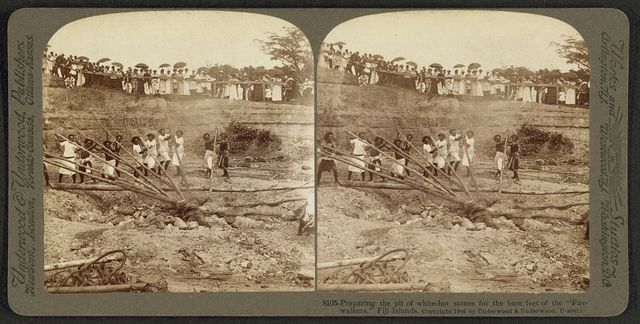 """Preparing the pit of white-hot stones for the bare feet of the """"fire-walkers"""", Fiji Islands"""