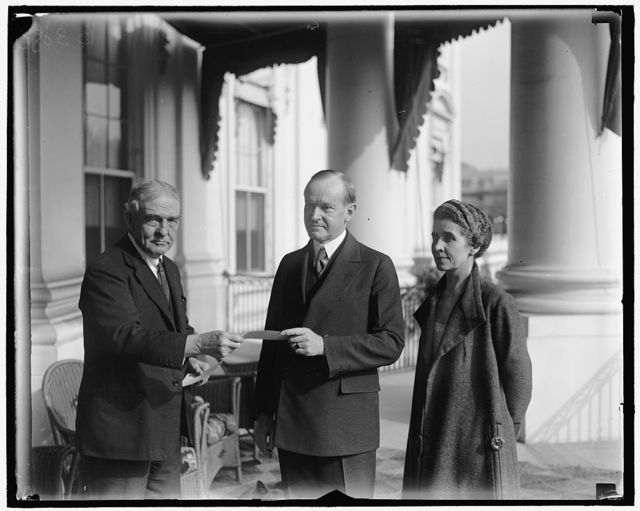 President and Mrs. Coolidge enrolled in American Red Cross by Judge John Barton Payne. The twelfth annual roll call of the American Red Cross was officially opened in Washington today when President and Mrs. Coolidge were enrolled for their annual memberships by Judge John Barton Payne, chairman of the American Red Cross
