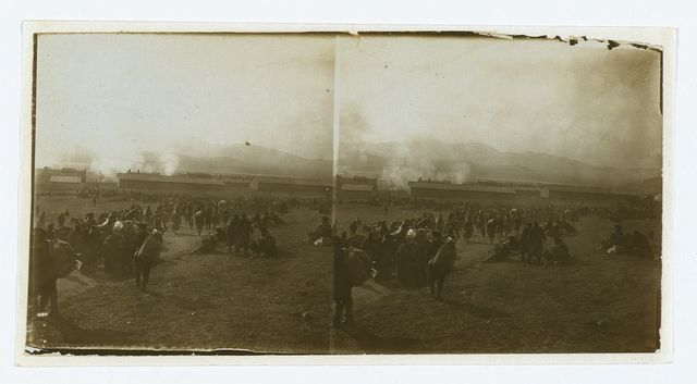 [Prisoners of war waiting for trains -- watching burning of abandoned stores -- Port Arthur]