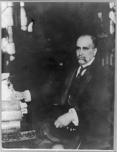 [Professor William Osler, half-length portrait, seated at desk]