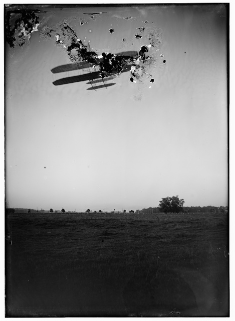 [Rear view of flight 46, Orville flying at a high altitude over Huffman Prairie, Dayton, Ohio]