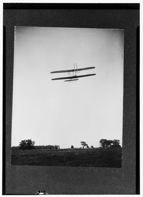 [Rear view of flight 46, Orville shown flying at a high altitude over Huffman Prairie, Dayton, Ohio.]