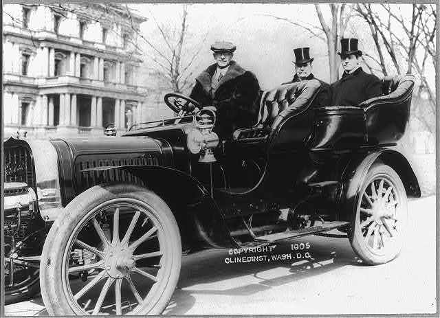 [Senators Albert J. Beveridge and Albert Jarvis Hopkins in the back seat of a chauffeured automobile, with State, War and Navy building in background]