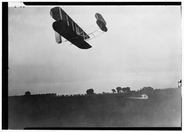 [Side view of flight 41, showing the machine traveling to the right, with double horizontal rudder in front and double vertical rudder behind, as Orville flew 12 miles at Huffman Prairie, Dayton, Ohio]