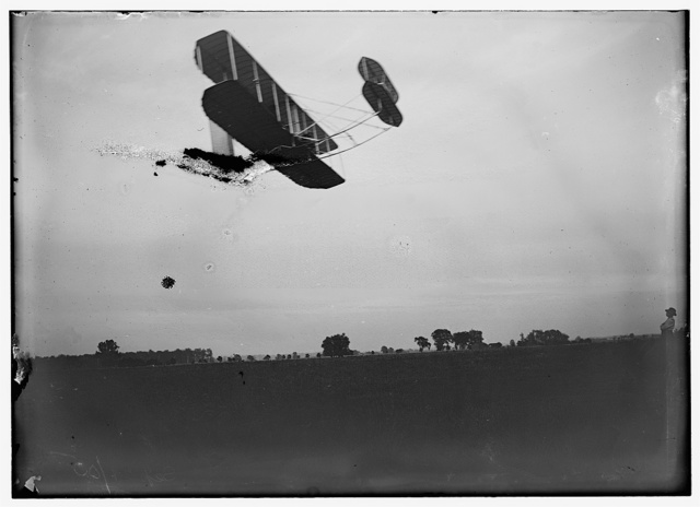 [Side view of flight 41, showing the machine traveling to the right, with double horizontal rudder in front and double vertical rudder behind, as Orville flew 12 miles; Huffman Prairie, Dayton, Ohio]