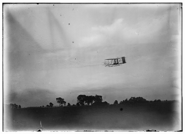 [Side view of flight 45, Orville flying to the left at a considerable height; Huffman Prairie, Dayton, Ohio]