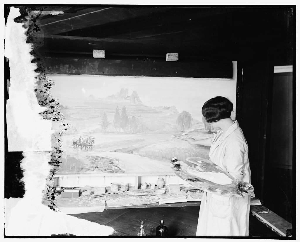 Soil erosion takes a toll of millions of dollars in the United States annually. The causes of this drain upon productive lands and preventive measures are graphically shown in an exhibit prepared by the Office of Exhibits of the United States Department of Agriculture for exhibition at the sesquicentennial exposition. Florence Bryant, an artist, is shown painting the exhibit