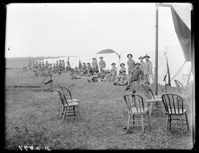 Soldiers outside their tents at the Nebraska National Guard Camp, Kearney, Nebraska