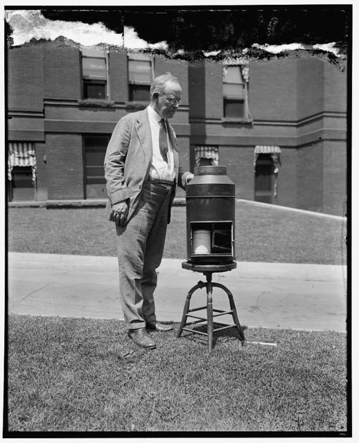 S.P. Ferguson with gauge which measures snow and hail