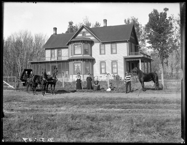 State legislator Link Milburn and his family in front of their home at Overton, Nebraska.