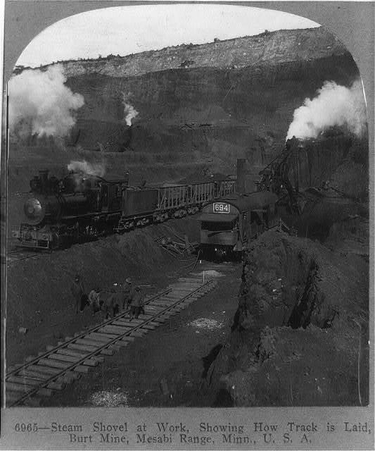 Steam shovel at work, showing how track is laid, Burt mine, Mesabi Range, Minn., U.S.A.