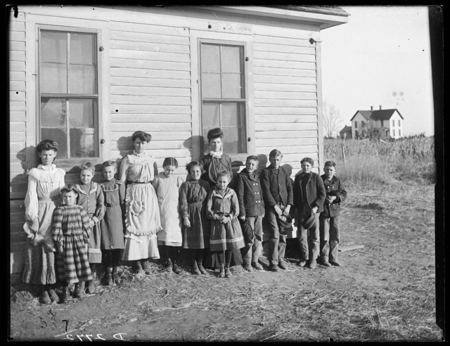 Students and teacher, Miss Ada Phillips, at the Cozad Grade School, Cozad, Dawson County, Nebraska.