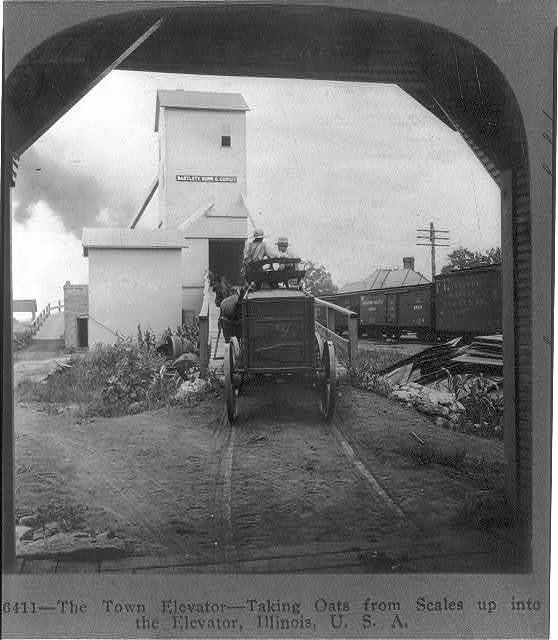 The town elevator--taking oats from scales up into the elevator, Illinois, U.S.A.