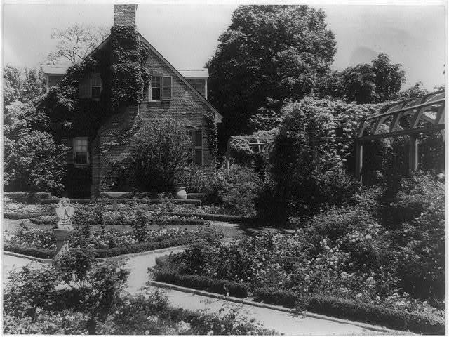 [York Hall, York Co., Va., exterior, with flower garden in foreground] / Frances Benjamin Johnston, Washington, D.C.
