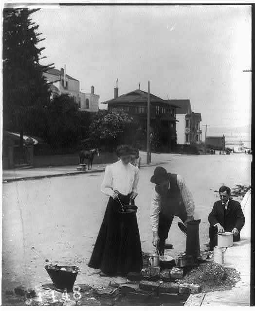 [2 men and a woman cooking on the street after the San Francisco earthquake and fire]