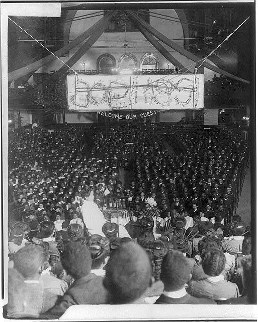 "[25th anniversary of Tuskegee Inst., Ala., 1906: Assembly with banner reading ""Welcome Our Guests""]"