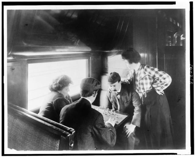 [A game of chess in a tourist sleeper] / photo by the Geo. R. Lawrence Co.