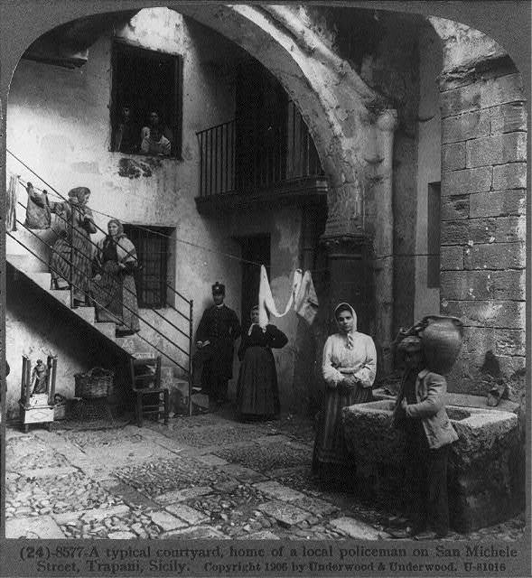 A typical courtyard, home of a local policeman on San Michele Street, Trapani, Sicily