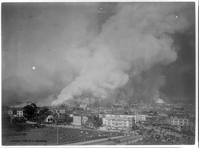 [Bird's-eye view of smoldering downtown section during the San Francisco earthquake and fire]