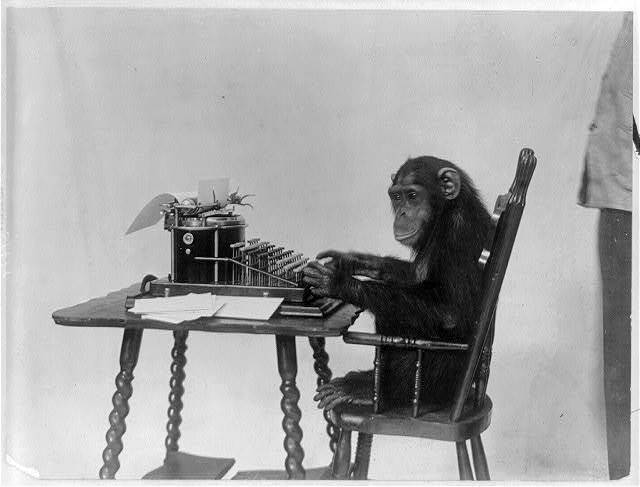 [Chimpanzee seated at a typewriter]