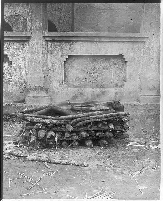 [Corpse beginning to burn on pyre, India]