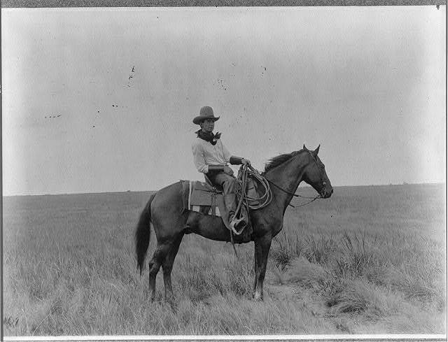 [Erwin E. Smith, full-length portrait, facing right, on horseback]