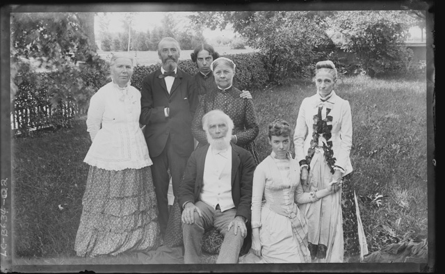 [Group portrait of members of the Blackwell family outside on a lawn]