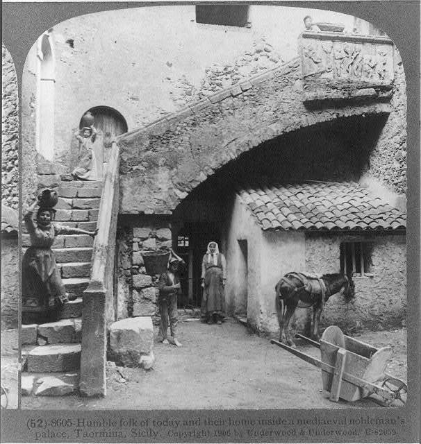 Humble folk of today and their home inside a mediaeval nobleman's palace, Taormina, Sicily