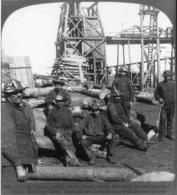 Iron miners before shaft house, ready for work in underground shafts, Hibbing, Minn.
