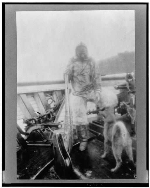 """Matt Henson (of Peary's crew) in Arctic costume on deck of the """"Roosevelt"""" on arrival at Sidney, Nova Scotia"""