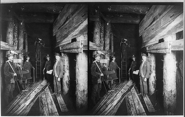 Miners pose in coal mine