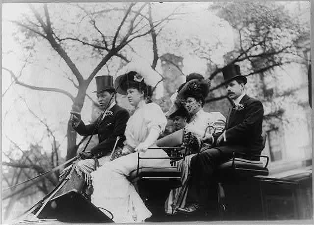 [Mr. and Mrs. Goodby Loew riding in open carriage with a man and two other women]