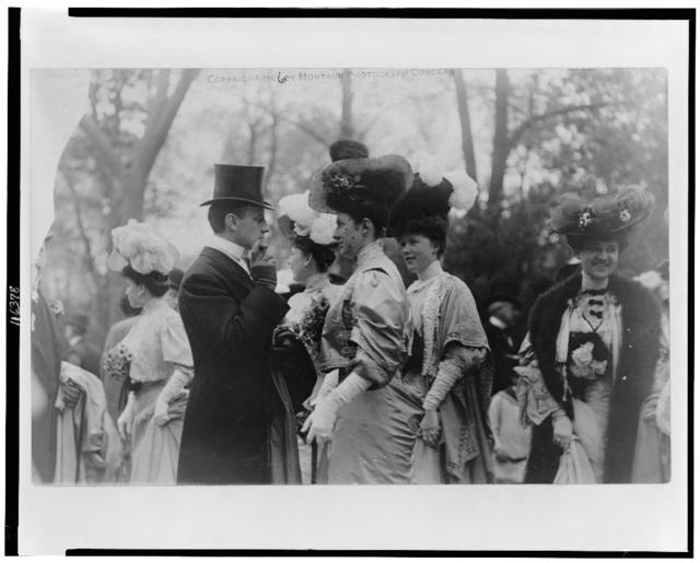 [Mr. & Mrs. Goodhue Livingston and Mrs. Alfred Gwynne Vanderbilt at an outdoor social gathering for the annual parade of the coaching club]