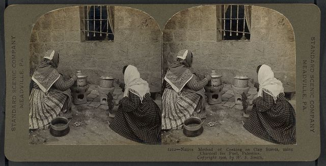 Native method of cooking on clay stoves, using charcoal for fuel, Palestine