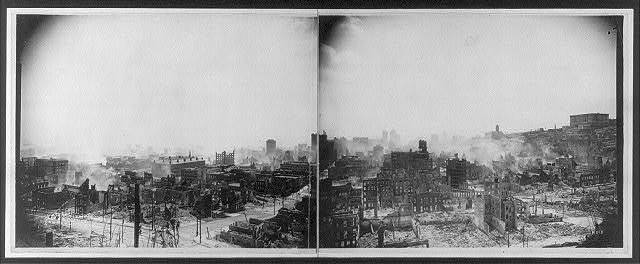 [Panoramic view of the aftermath of the San Francisco earthquake and fire, showing ruins of buildings and smoke]