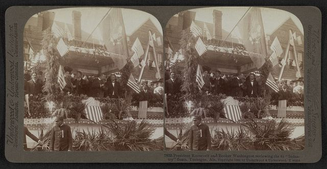 """President Roosevelt and Booker Washington reviewing the 61 """"industry"""" floats, Tuskegee, Ala."""