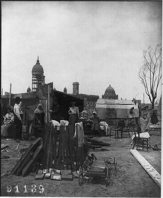 San Francisco Earthquake and Fire: people with temporary living quarters in foreground - ruins in background