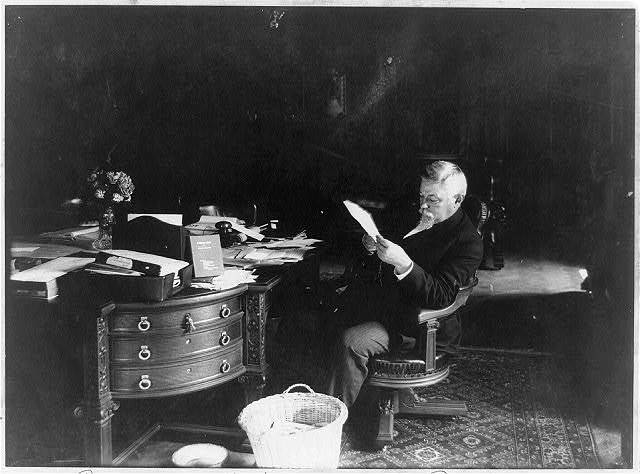 [State Capitol, Harrisburg, Pennsylvania: Governor Pennypacker reading in his private office]