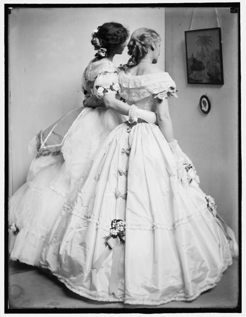 [The silhouette, a study posed by the Gerson sisters in their Crinoline Ball costumes]