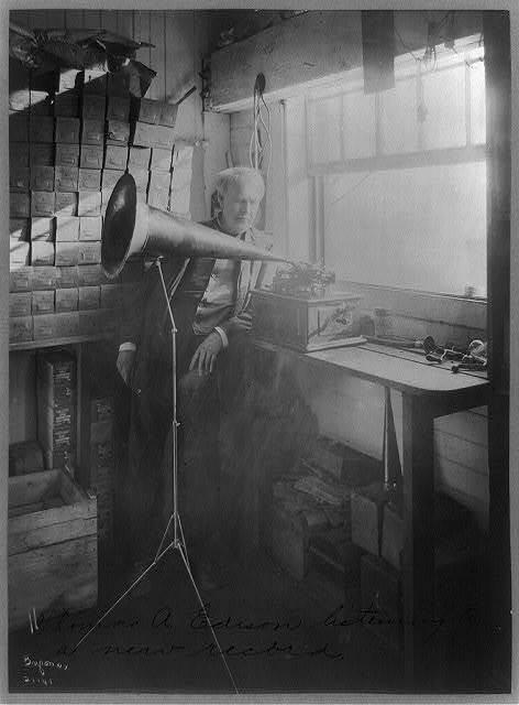 [Thomas Alva Edison, full-length portrait, standing, facing right, listening to a new record]